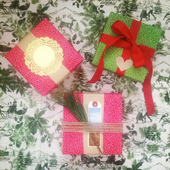 To: Mother 3 re-usable boxes adorned with (L) kraft paper strip and gold foil doily, (R) ribbon and kraft paper heart, (C) twine, pine, and photographic luggage tag