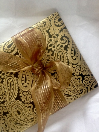 Opulent gold and black paisley with gold ribbon