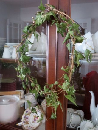 Spur of the moment Ivy wreath hung from the china cabinet