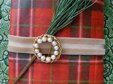 Plaid tissue paper, velvet ribbon, vintage brooch, pine branch